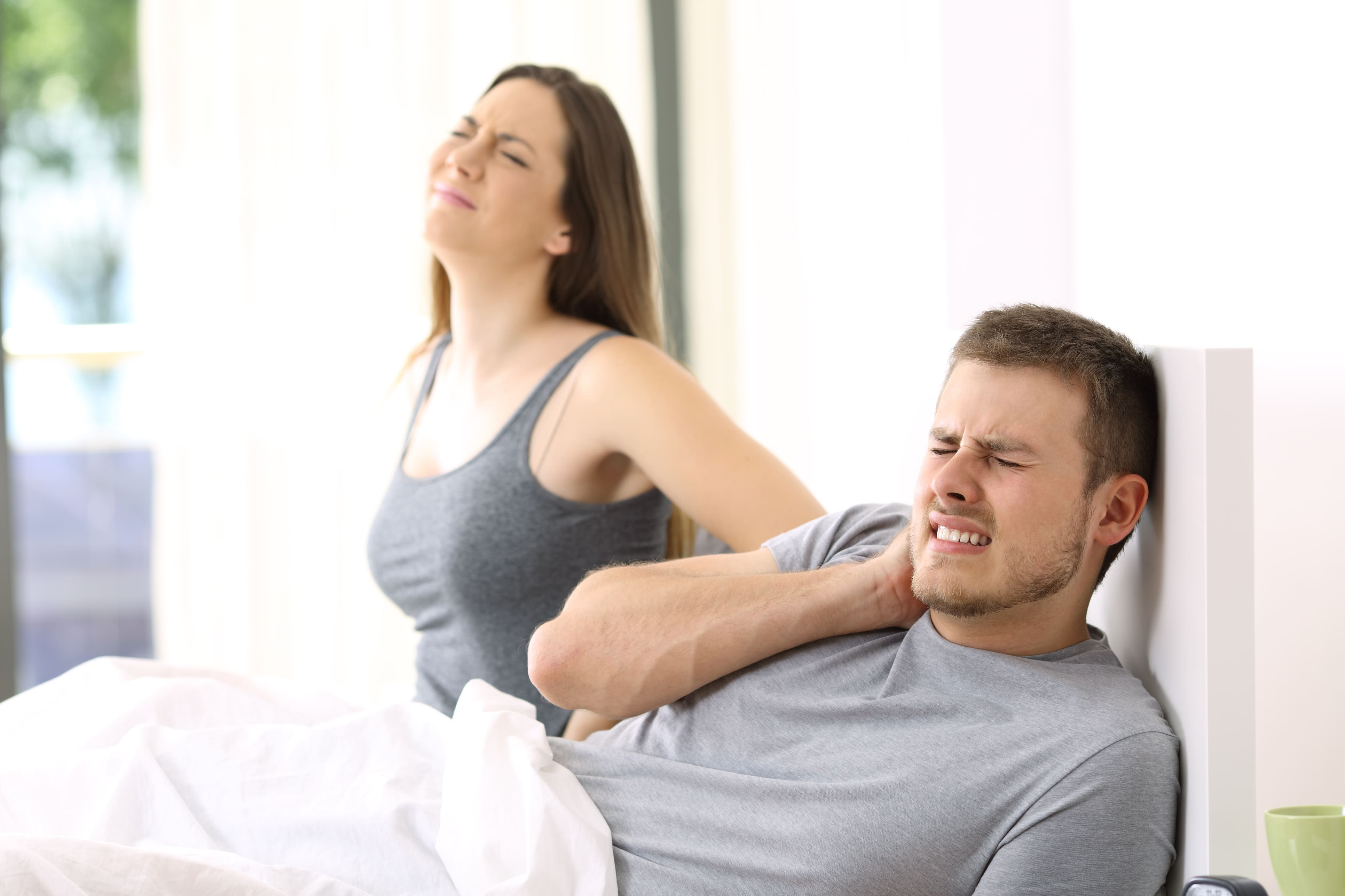couple in pain after sleeping on bad mattress