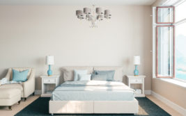 light grey and blue mattress with cool crisp sheets and white wood bedside tables