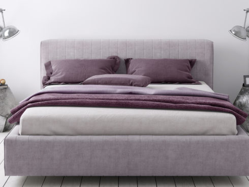 clean made mattress with purple sheets and modern geometric nightstands with lamps